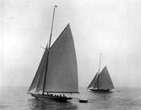Shamrock IV with Shamrock III in the background, c1920
